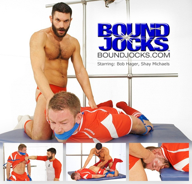 Bound Jocks Shay Michaels Bob Hager in  soccer kit-wrists restrained by rope to thighs