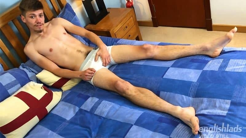 Young straight British dude Feldon Shaw strokes his massive uncut cock shooting cum all over his abs
