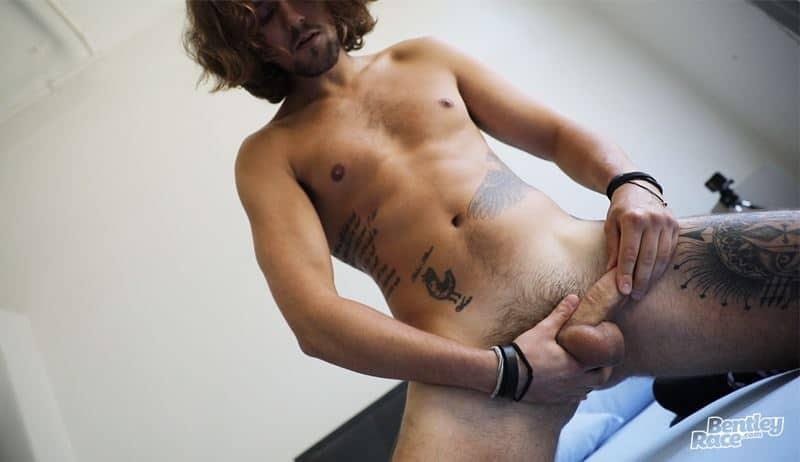 Hot young British stud Michael Kent strips down to his black socks and sneakers jerking his big uncut dick