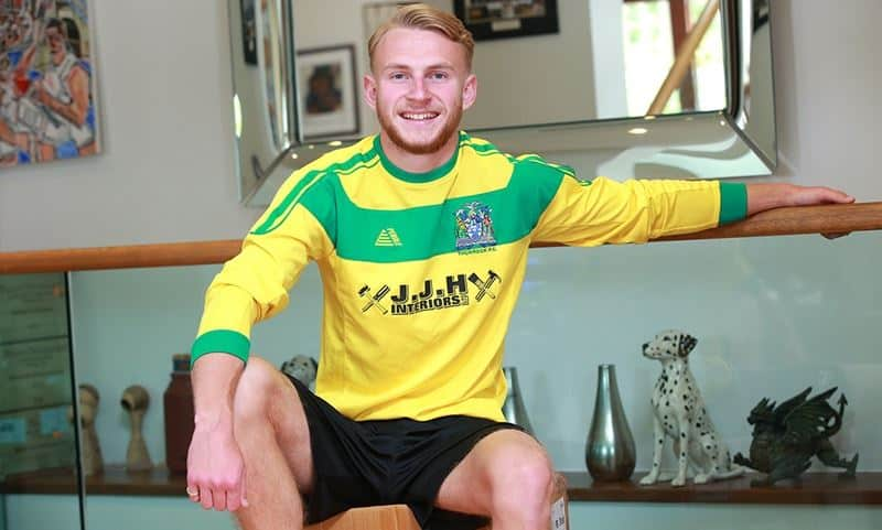 Hottie young straight footballer Isaac Sherringham strips out of his football kit jerking his huge uncut cock
